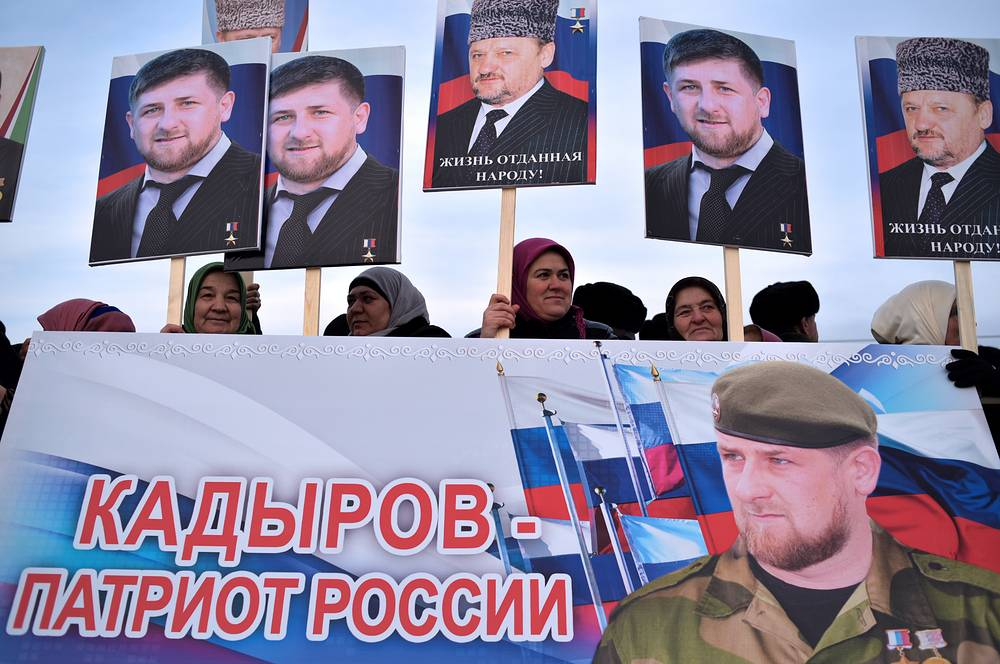 """The demonstrators holding poster """"Kadyrov is a Russian patriot"""""""