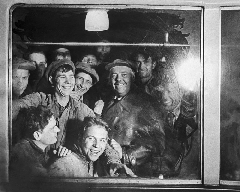 Underground construction workers riding a metro train, 1935