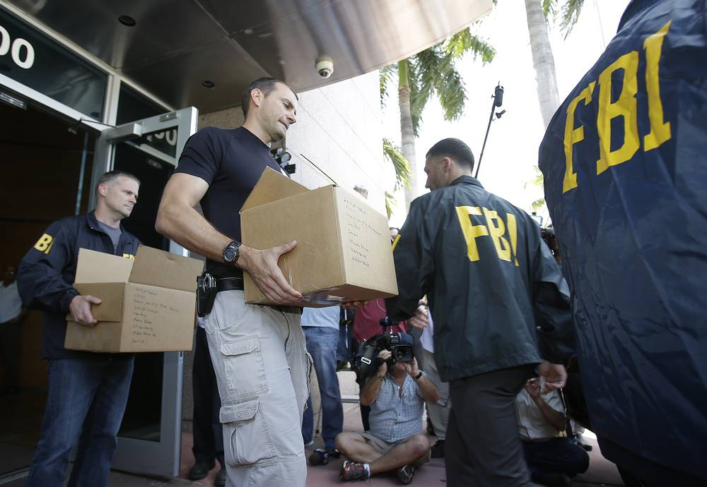 A chain of corruption scandals rocked FIFA in 2015. Everything flared up within an unprecedented scandal before the 65th FIFA Congress in Zurich, where seven of the organization's high-ranking officials were arrested in Switzerland on bribery, money laundering and corruption charges. Photo: Federal agents loading a van with boxes of evidence taken from the headquarters of the Confederation of North, Central America and Caribbean Association Football (CONCACAF,) in Miami, USA