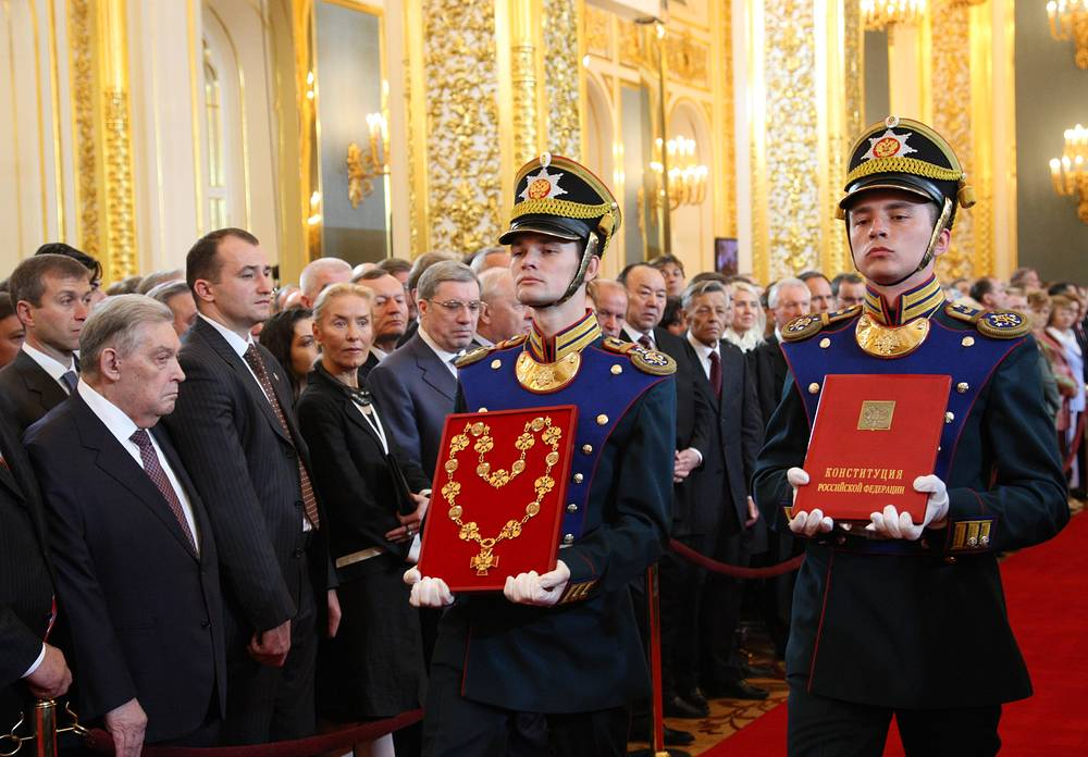 Guard of honour seen carrying official symbols of presidential power: The President's Badge of Office and the special copy of the Constitution of the Russian Federation prior to the inauguration ceremony in the Great Kremlin Palace