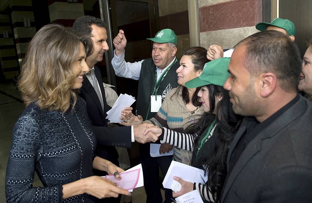 Syrian President Bashar Assad and his wife Asmaa at a polling station in Damascus