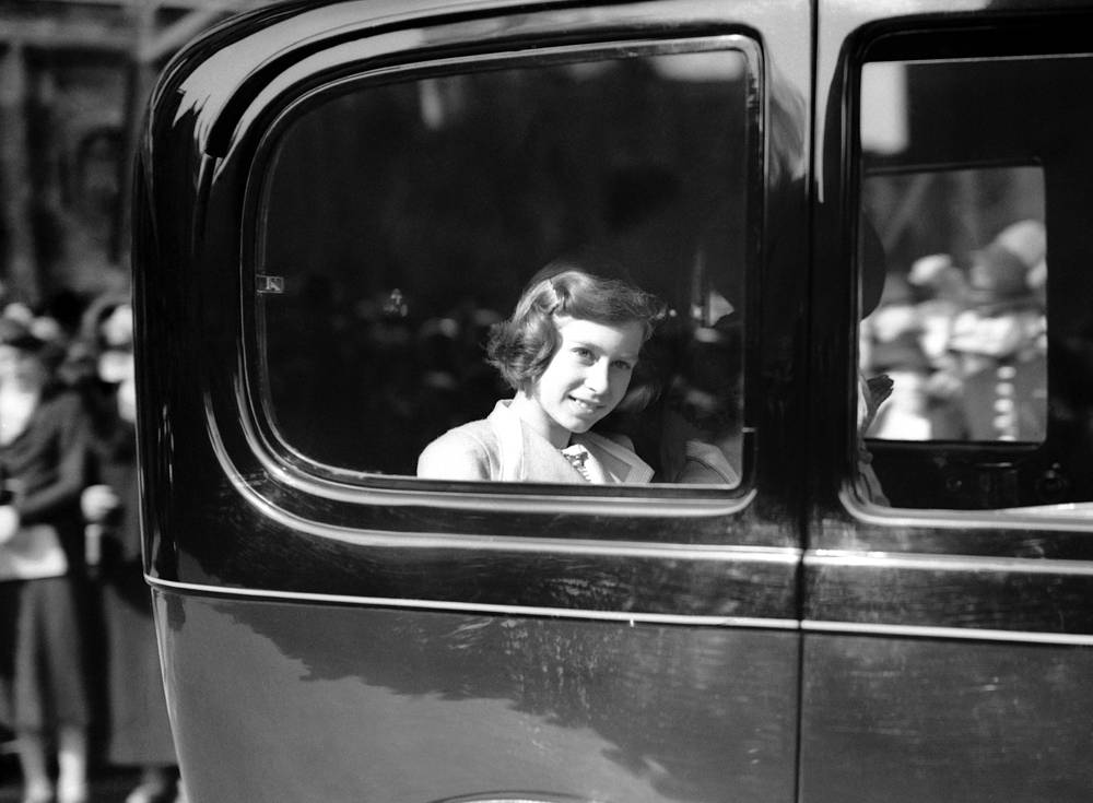 Princess Elizabeth is being driven away from the Albert Hall after attending the national festival of the schools' musical festivals of England, May 6, 1938