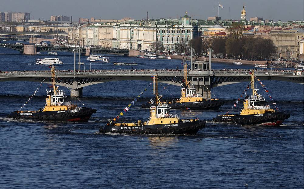 Tug boats dancing on the Neva River