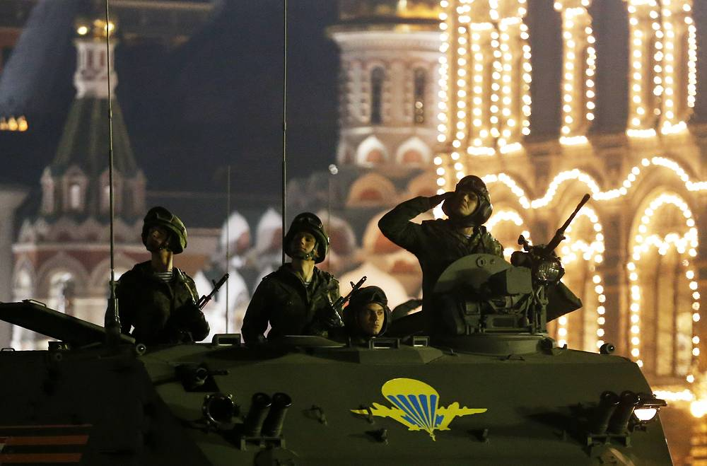 Russian servicemen on a military vehicle rolling down Moscow's Red Square during the rehearsal