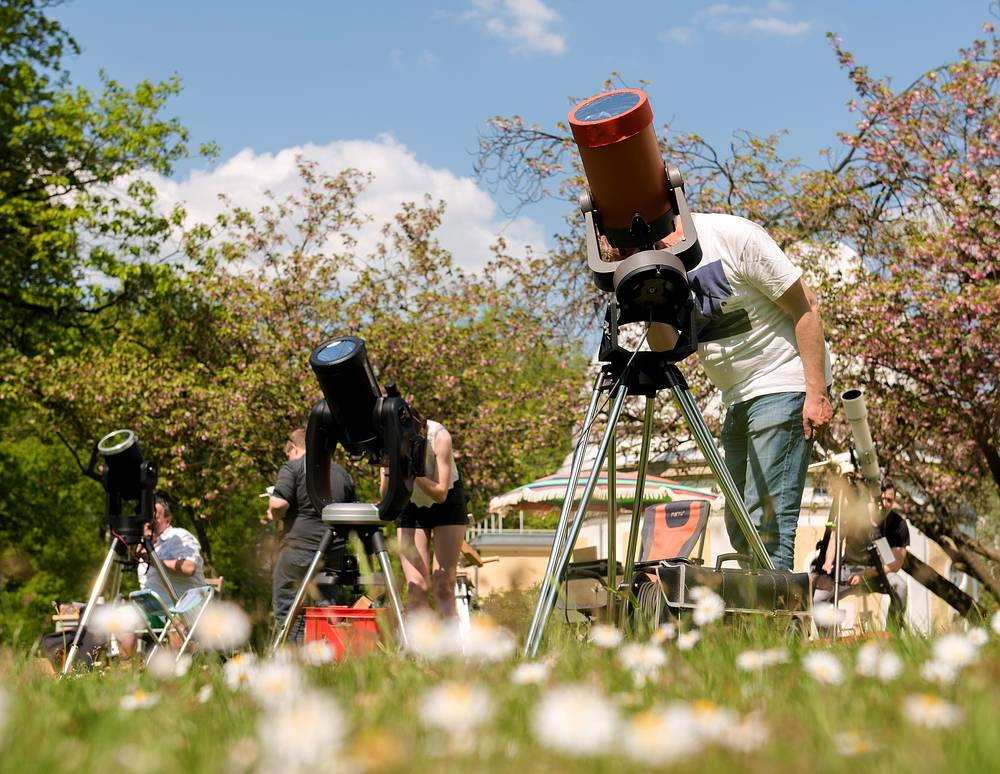 Amateur astronomers watching planet Mercury passing in front of the sun, on the grounds of the Bergedorf observatory, in Hamburg, Germany