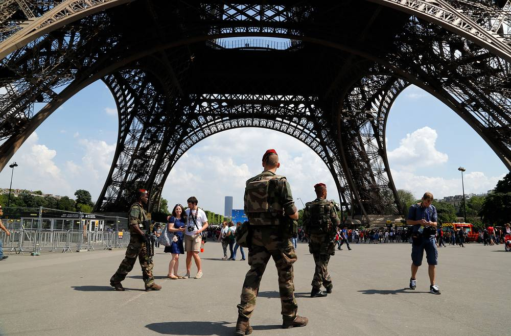 French soldiers patrol under the Eiffel Tower in Paris ahead of 2016 Euro Cup