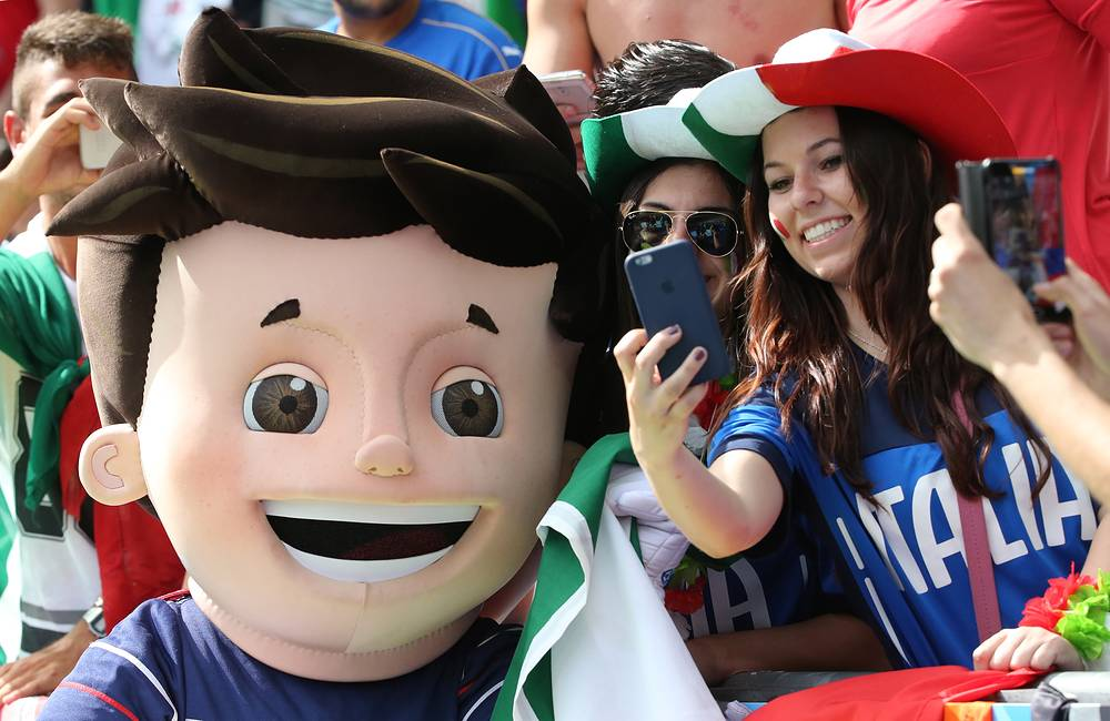 Euro 2016 mascot Super Victor and Italian fans before the Euro 2016 football match between Spain and Italy at Stade de France,  27 June 2016