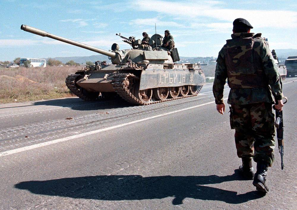 Soviet T-54/55 series tanks, introduced just as the World War II ended, became the most-produced tanks in military history. Estimated production numbers for the series range from 86,000 to 100,000. Photo: A Yugoslav Army soldier guards the road as T-55 tanks return to Pristina from Kosovo, 1998