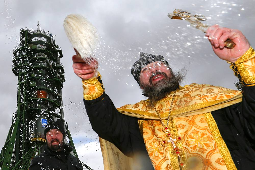 Orthodox priest conducts a blessing ceremony at the launch pad where the Soyuz FG rocket booster with the Soyuz MS-02 spacecraft was installed, at the Baikonur Cosmodrome