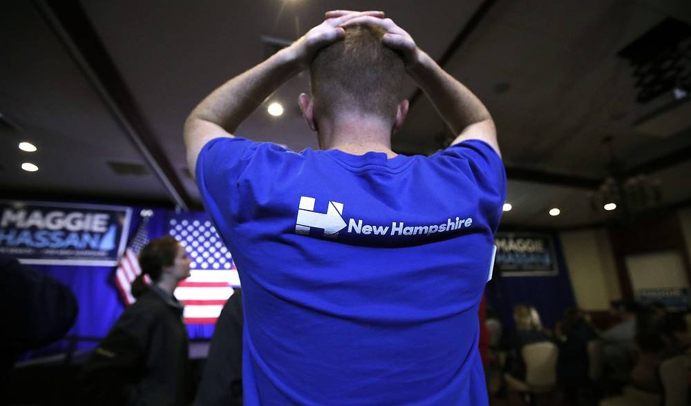 A Boston College student who volunteered for Democratic candidates watching election results in Manchester,