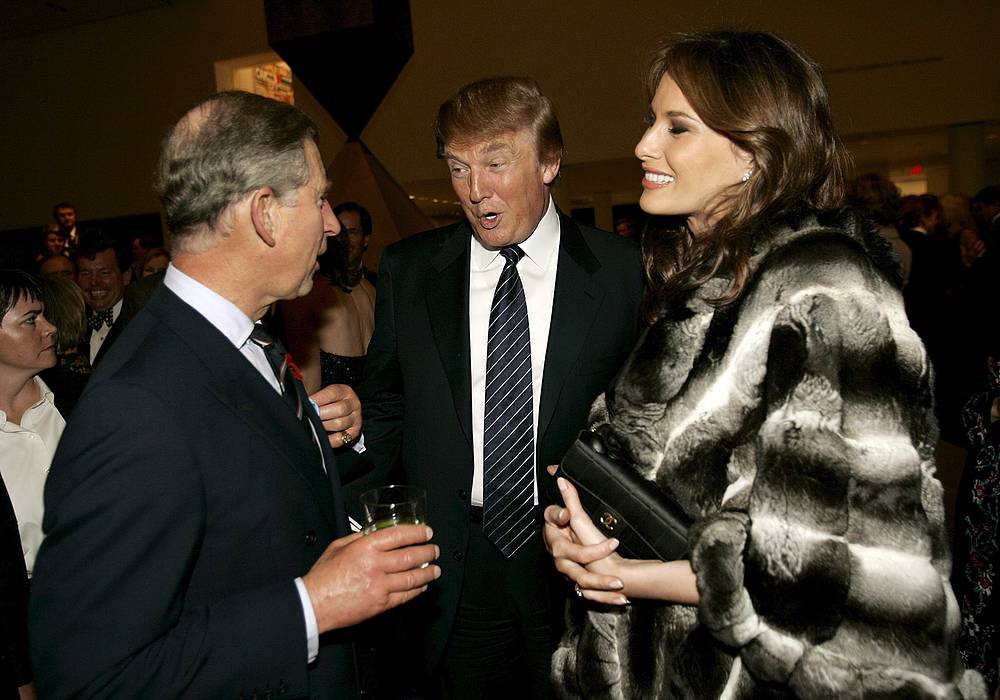 Prince Charles talks with Donald Trump and his wife Melania, November 1, 2005