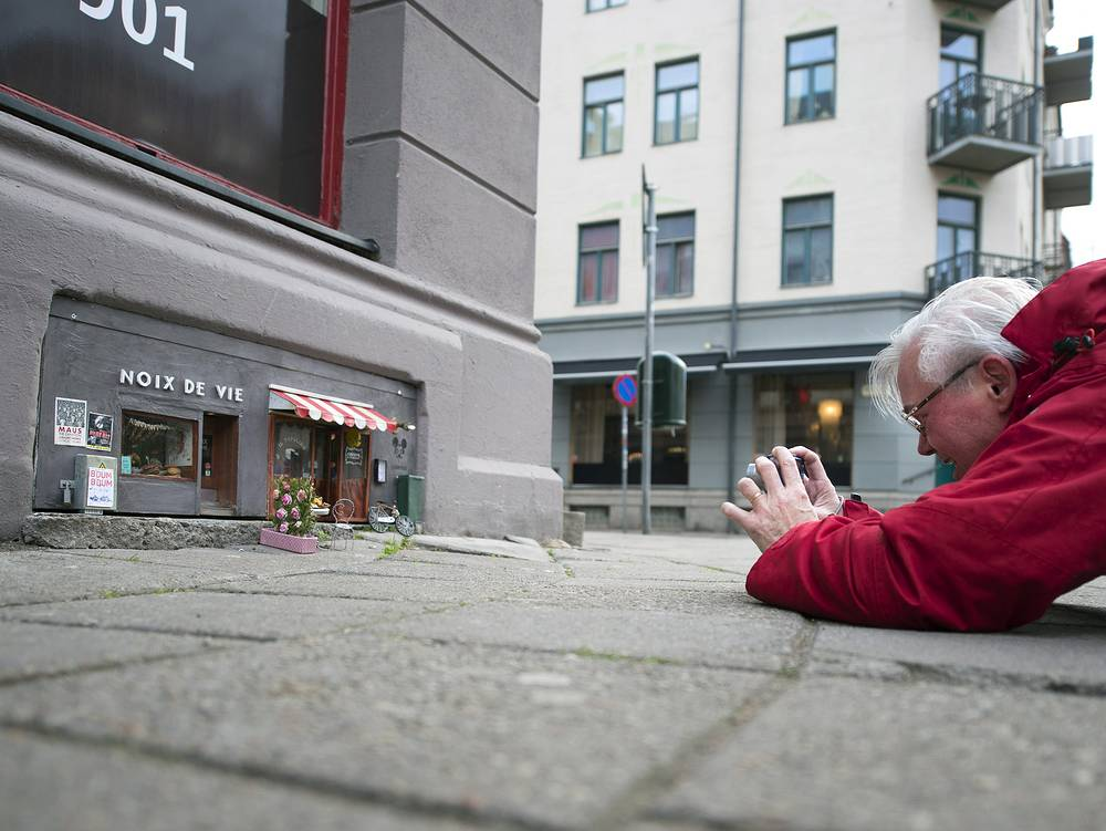 An unknown artist calling himself 'Anonymouse' has created a miniature restaurant and deli-shop for mice and rats in the Malmo city's center