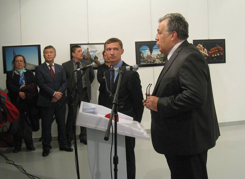 Russia's ambassador to Turkey, Andrey Karlov speaking just before he was shot by a gunman at the art exhibition in Ankara