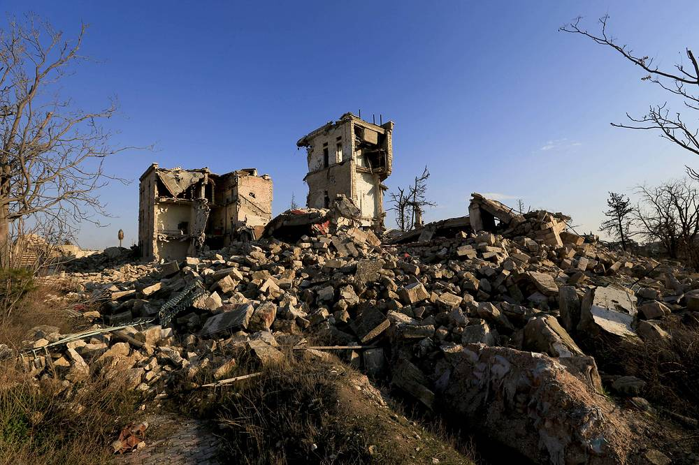 Mounds of rubble lie in place of high rise apartment buildings in the old city of Aleppo