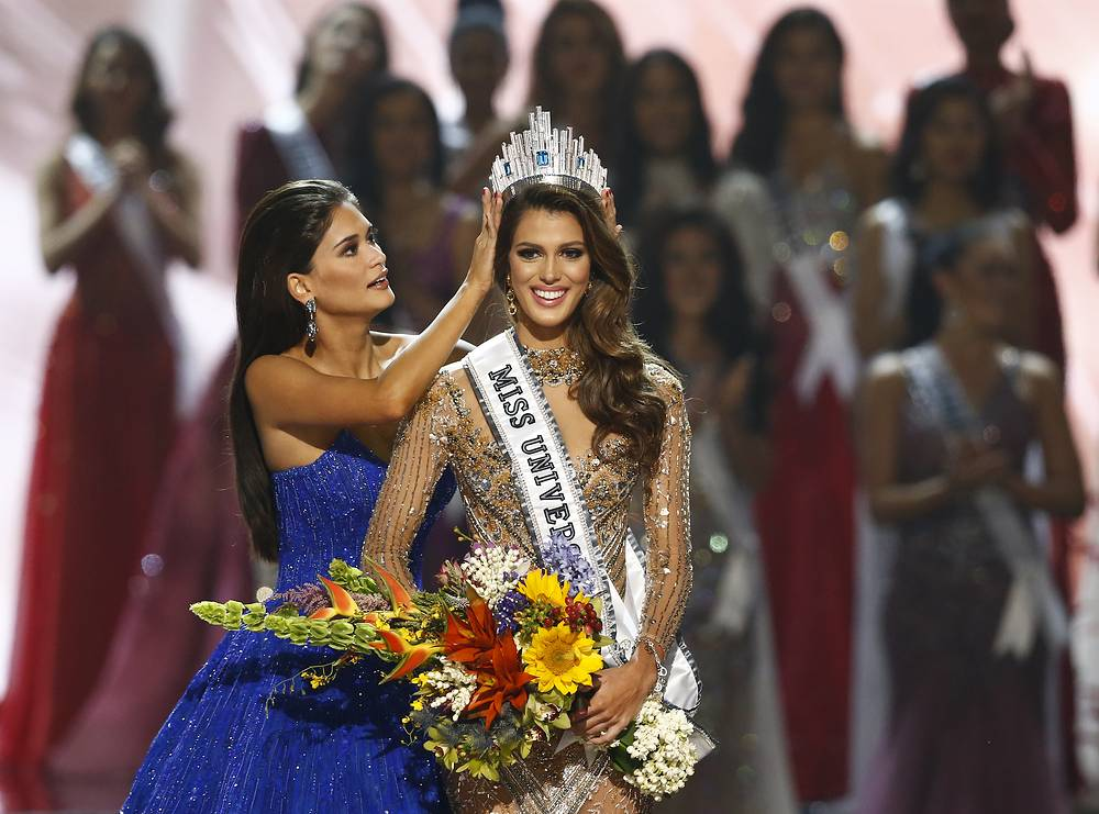 Iris Mittenaere from France is crowned the 65th Miss Universe by her predecessor, Pia Alonzo Wurtzbach from the Philippines during the coronation night of the Miss Universe pageant at the Mall of Asia Arena in Pasay City, Philippines