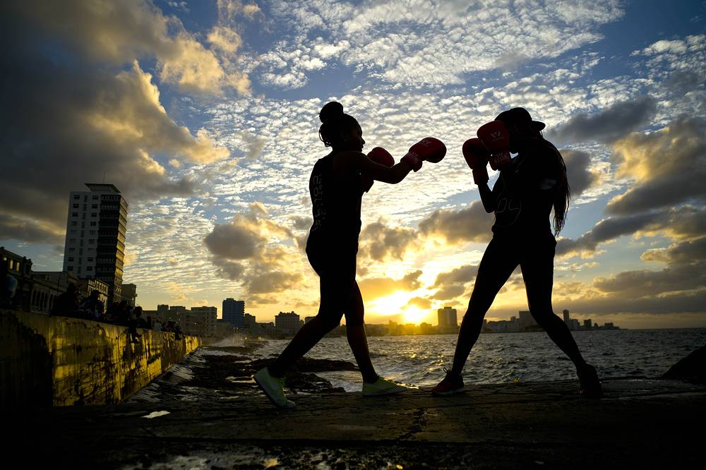 Female boxers train during a photo session on Havana's sea wall, in Cuba, January 30