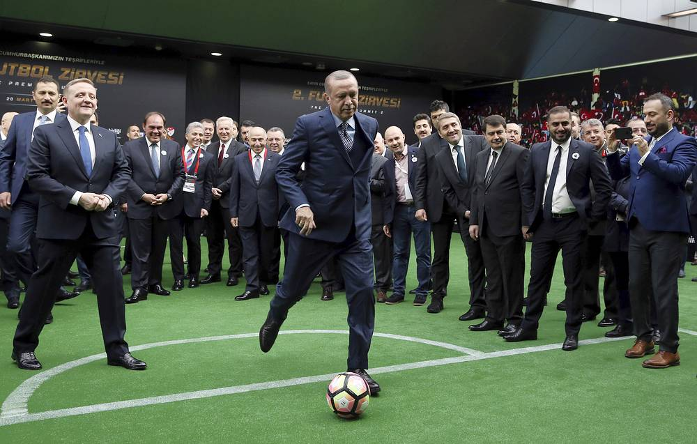 Turkey's President Recep Tayyip Erdogan kicks a ball during a soccer summit in Istanbul, March 20