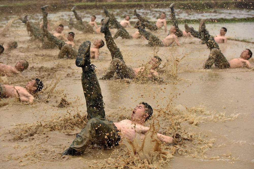 Paramilitary policemen attend a training session in Guigang, Guangxi Zhuang Autonomous region, March 28