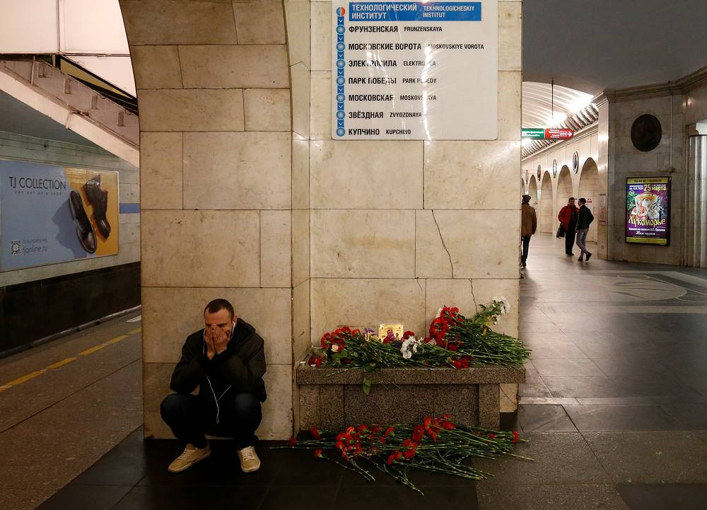 A man sits near the memorial site for the victims of a blast in St. Petersburg metro, at Tekhnologicheskiy institut metro station, Russia, April 4