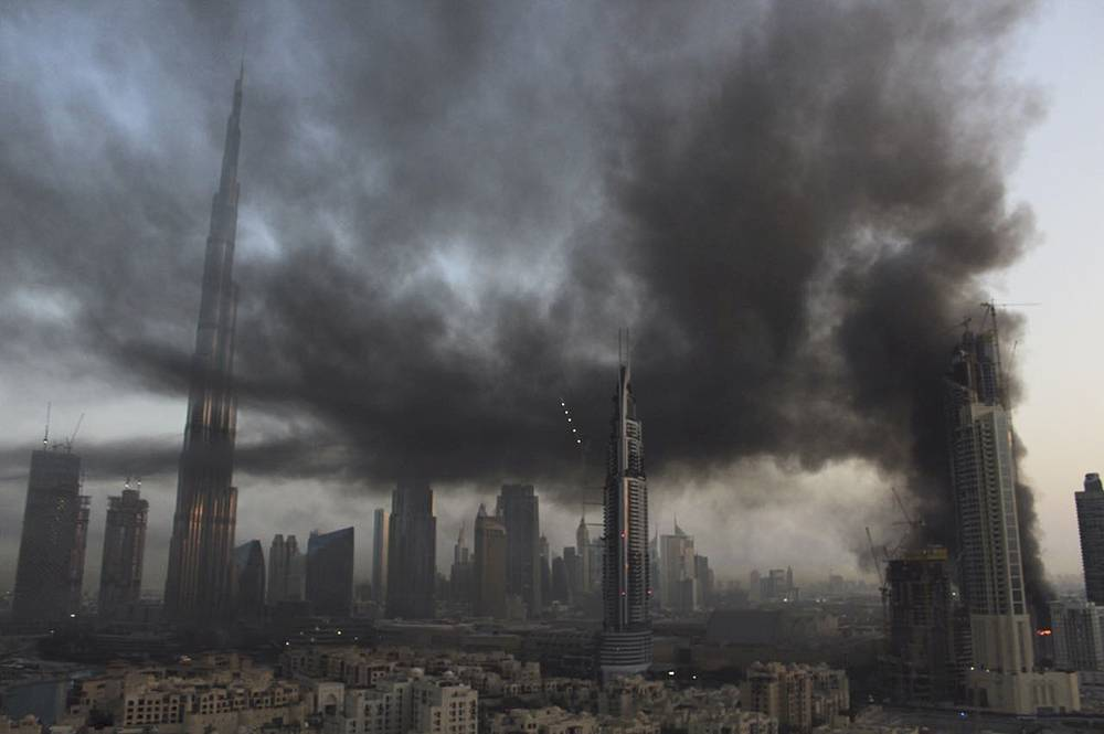 Smoke rises from a fire at a construction site next to Dubai Mall in Dubai, United Arab Emirates, April 2