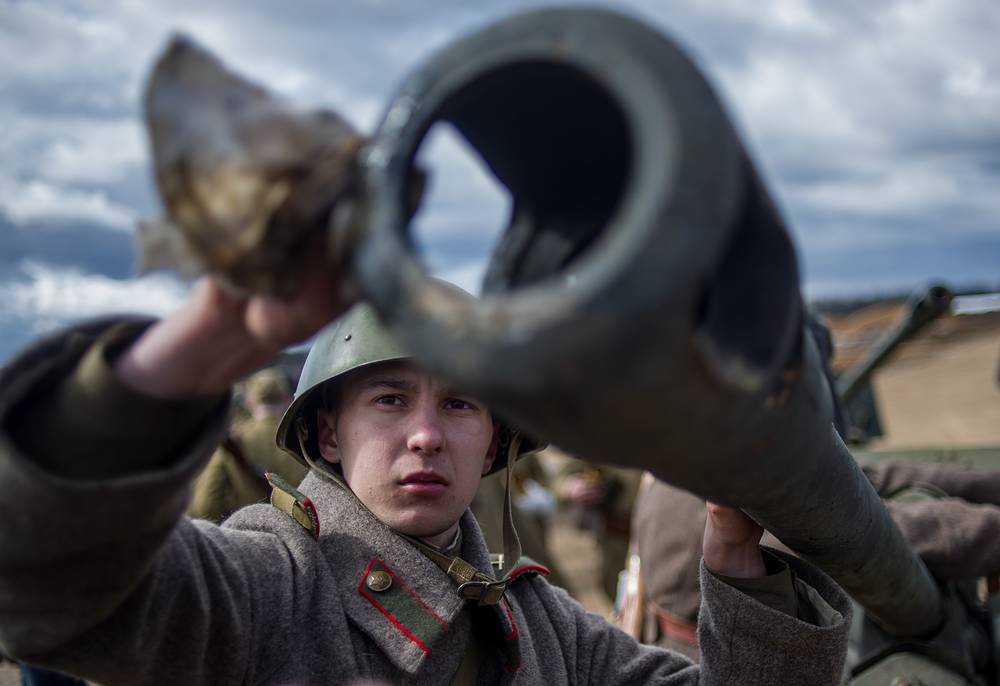 A participant dressed as a Soviet soldier ahead of a historical reconstruction of the Battle of Berlin fought on the Eastern Front of World War II, at the Patriot Park in Moscow region