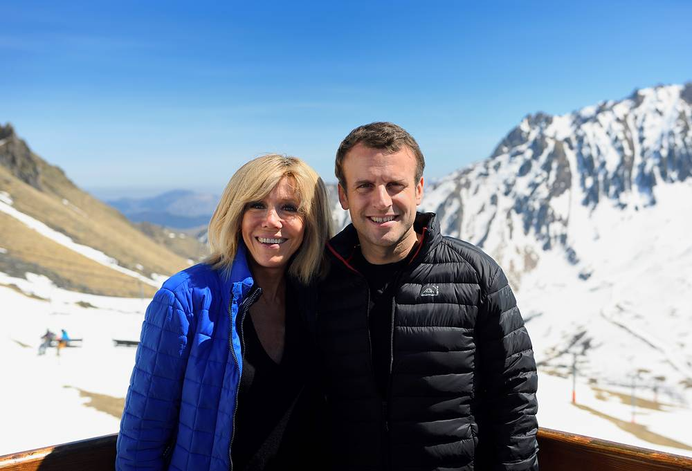 Emmanuel Macron and his wife Brigitte pose during a campaign visit in Bagneres de Bigorre, southwestern France, April 12, 2017