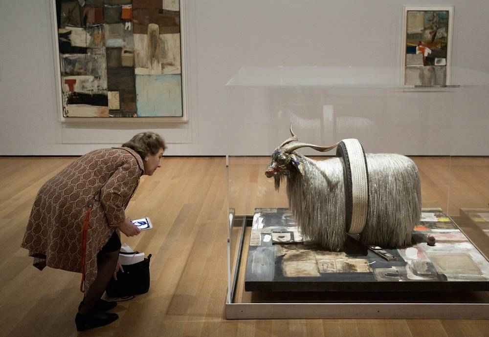 A woman looks at the sculpture 'Monogram' by US artist Robert Rauschenberg during a preview of the retrospective exhibit 'Robert Rauschenberg: Among Friends' at the Museum of Modern Art in New York, USA, May 16