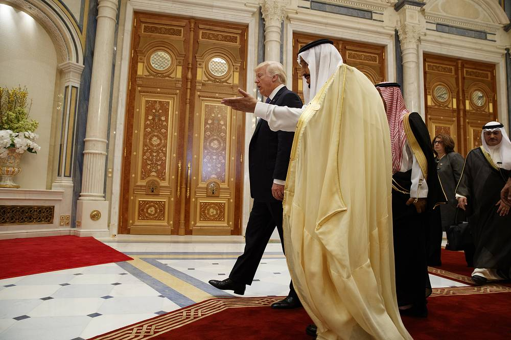 US President Donald Trump walking with Saudi King Salman at the King Abdulaziz Conference Center  in Riyadh