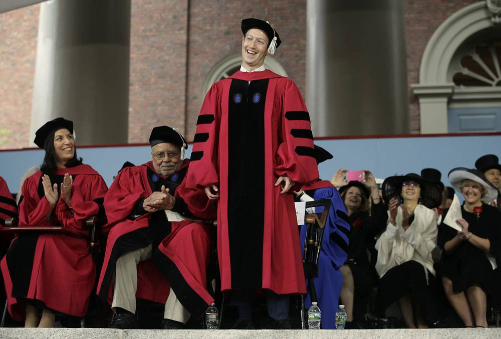 Facebook CEO and Harvard dropout Mark Zuckerberg smiles as he is introduced before being presented with an honorary Doctor of Laws degree during Harvard University commencement exercises in Cambridge, May 25
