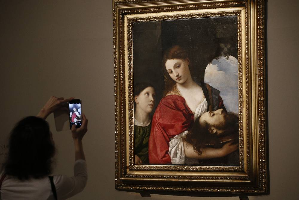 A visitor takes pictures of Salome by Titian dating from the early 16th century