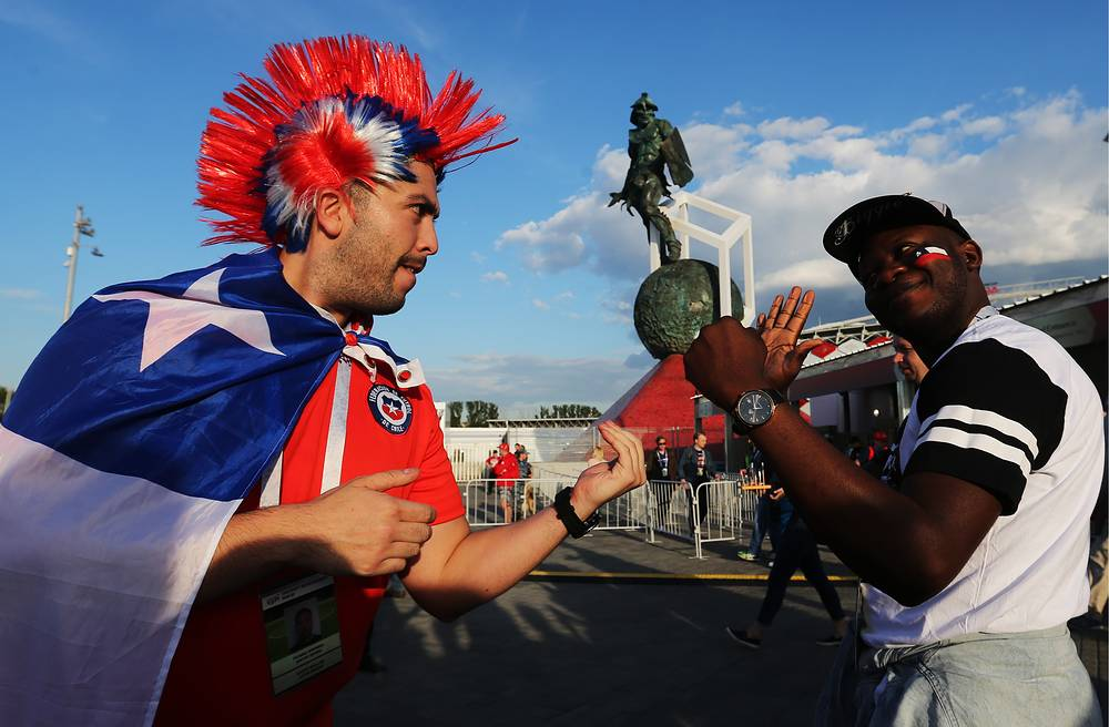 Chilean and Cameroonian football fans seen outside Spartak Stadium ahead of the Group B football match between Chile and Cameroon