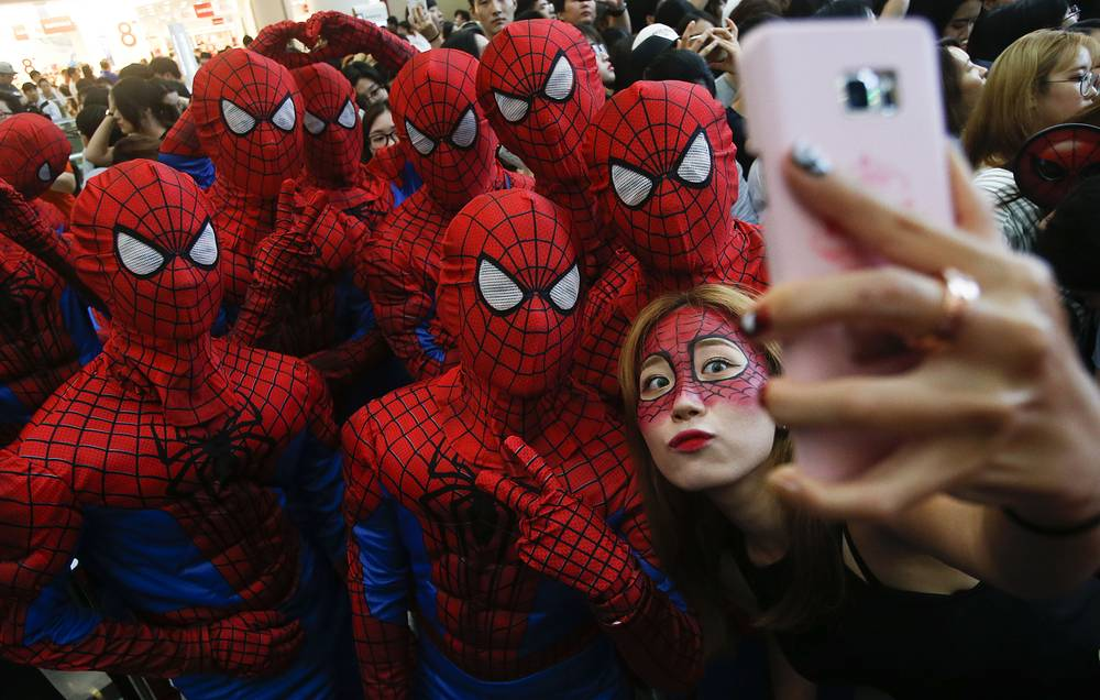 People wearing Spider-Man costumes and make-up take a selfie at the premiere of 'Spider-Man: Homecoming' at the Yeongdeungpo Time Square CGV theater in Seoul, South Korea,July 2