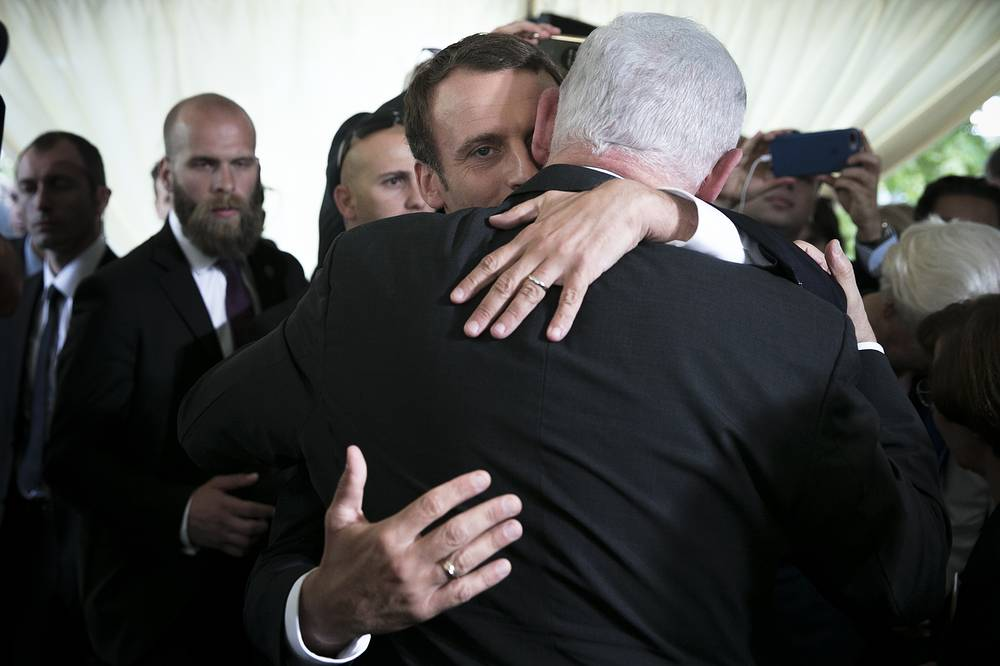 French President Emmanuel Macron embraces Israeli Prime Minister Benjamin Netanyahu after a ceremony commemorating the 75th anniversary of the Vel d'Hiv roundup in Paris, France, July 16