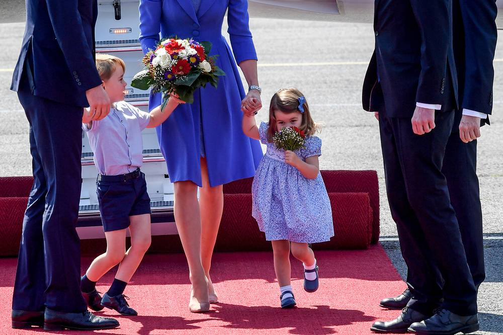 Britain's Prince William, Duke of Cambridge and Catherine, Duchess of Cambridge with their children Prince George and Princess Charlotte during a welcome ceremony at the airport in Berlin, Germany, July 19