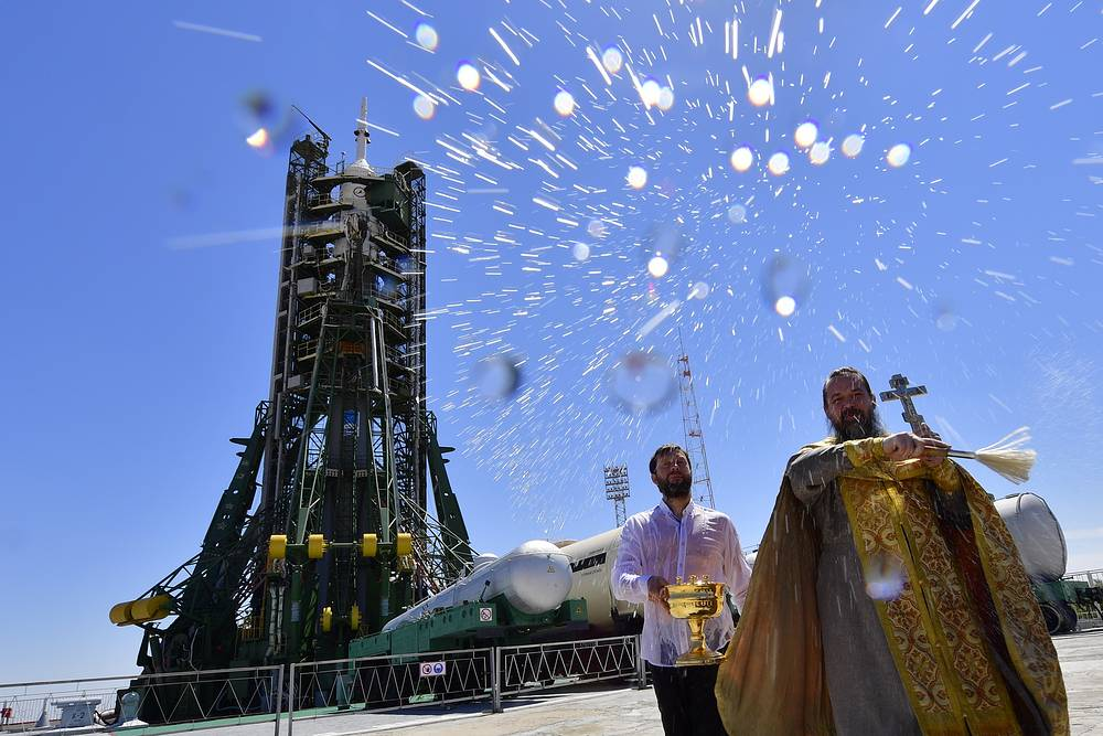 An Orthodox priest conducts a blessing ceremony at the launch pad where the Soyuz FG rocket booster with the Soyuz MS-05 spacecraft has been installed, at the Baikonur Cosmodrome, July 27