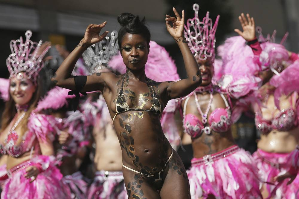 Costumed revellers perform in the Notting Hill Carnival in London, UK, August 28