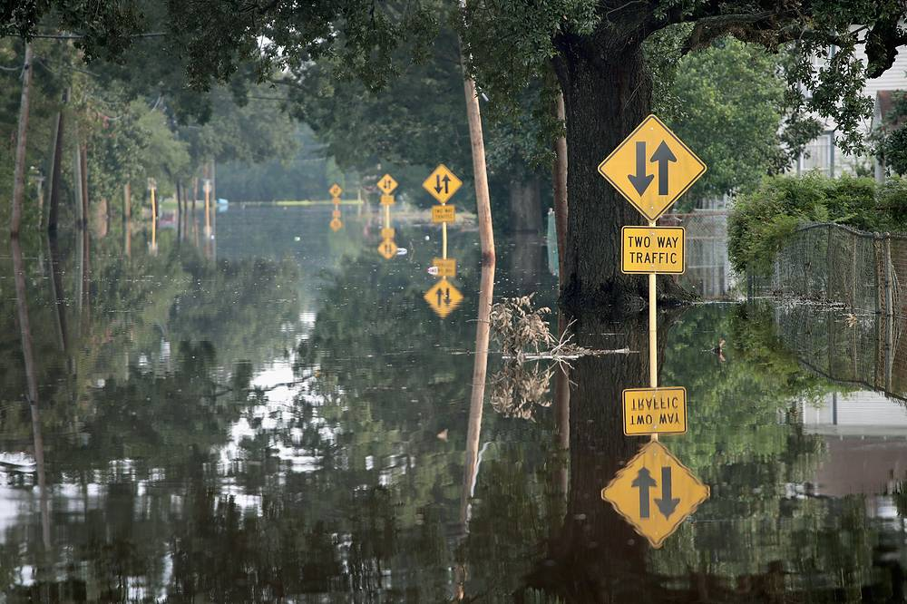A street is covered with floodwater after torrential rains pounded Southeast Texas following Hurricane and Tropical Storm Harvey causing widespread flooding in Orange, Texas, USA, September 3