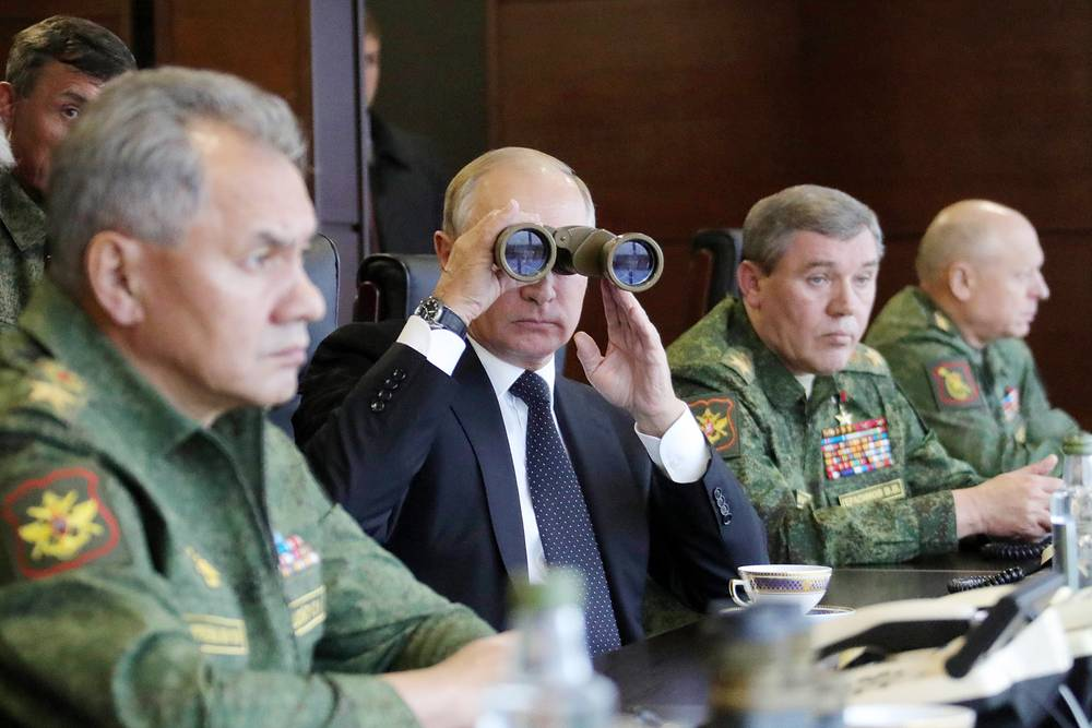 Russia's Defense Minister Sergei Shoigu, Russia's President Vladimir Putin and Russia's First Deputy Defense Minister, Chief of the General Staff of the Russian Armed Forces Valery Gerasimov attend the main stage of Zapad 2017, joint Russia-Belarus military exercises, at Luzhsky range, Russia, September 18