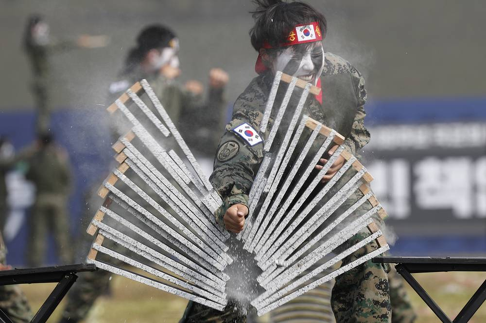 A South Korean Special Army female soldier performs 'Teukgong martial arts' during the media day for the 69th anniversary of the Armed Forces Day at the 2nd Fleet Parade Ground in Pyeongtaek, South Korea, September 25