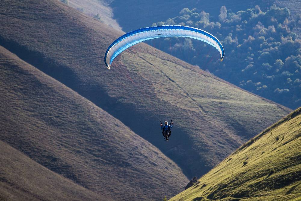 Flying paragliders in the mountains of the Kabardino-Balkar Republic, Russia, September 30