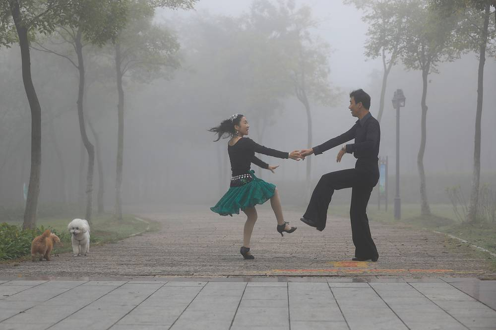 Dancing in the park on a foggy day in Huaian, China, October 10