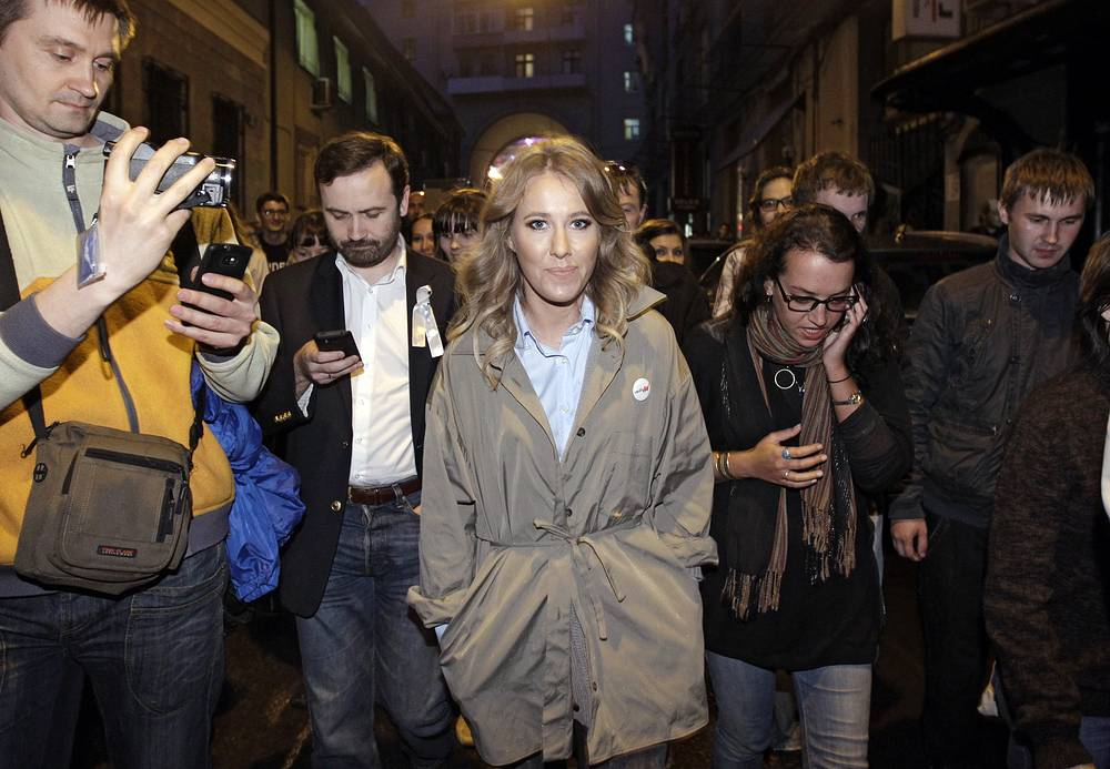 In recent years, Sobchak has become known as an opposition figure. Photo: Ksenia Sobchak, center, walk with protesters in downtown Moscow, 2012 a day after Vladimir Putin's inauguration