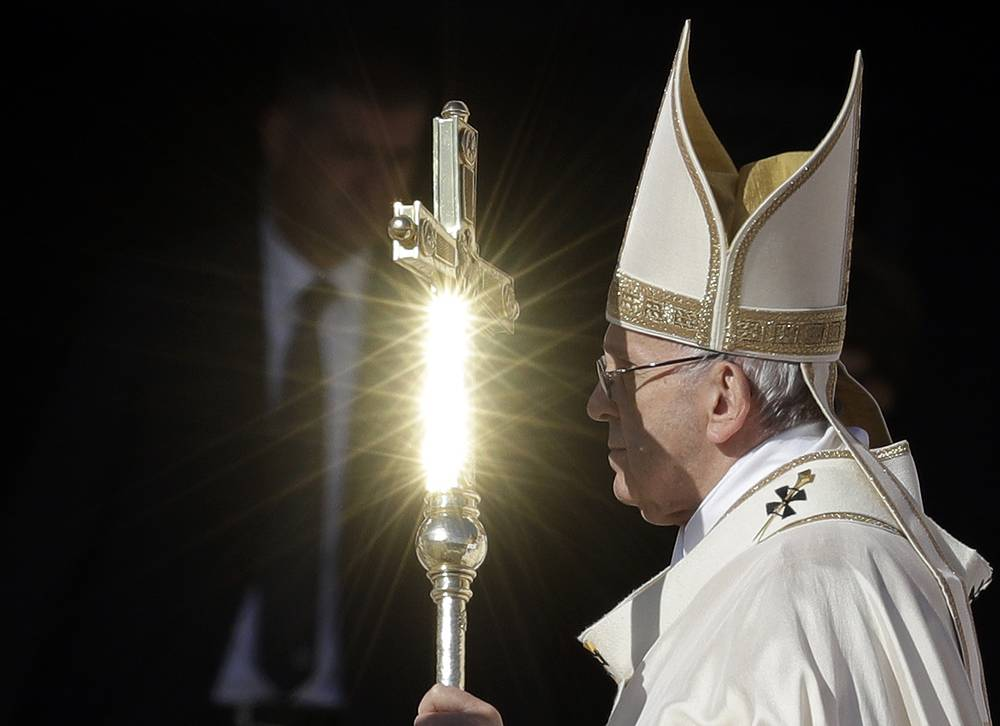 Pope Francis' pastoral staff is hit by a ray of the sun during the canonization mass for 35 new saints in St. Peter's Square at the Vatican,  October 15