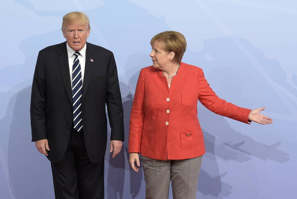 US President Donald Trump is welcomed by German Chancellor Angela Merkel on the first day of the G-20 summit in Hamburg, Germany, 2017