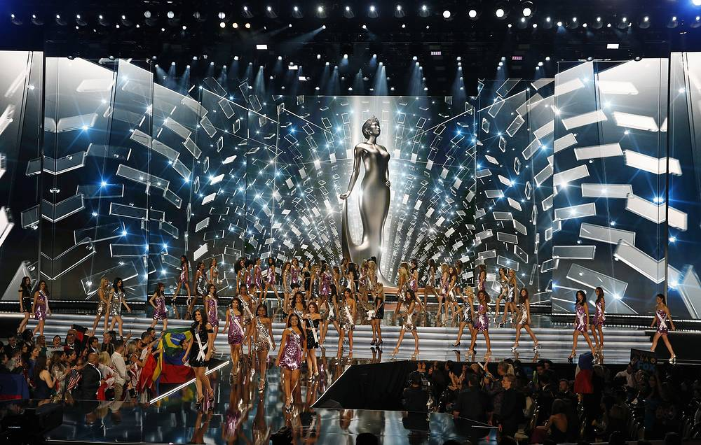 Contestants walk across the stage at the Miss Universe pageant