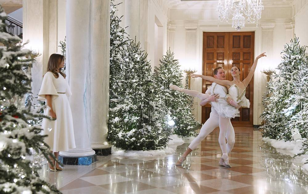 Ballet dancers perform as US first lady Melania Trump begins a tour of the holiday decorations at the White House in Washington