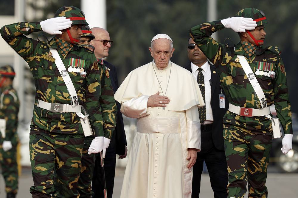 Pope Francis reviews a honor guard as he arrives at Dhaka's international airport, Bangladesh, November 30
