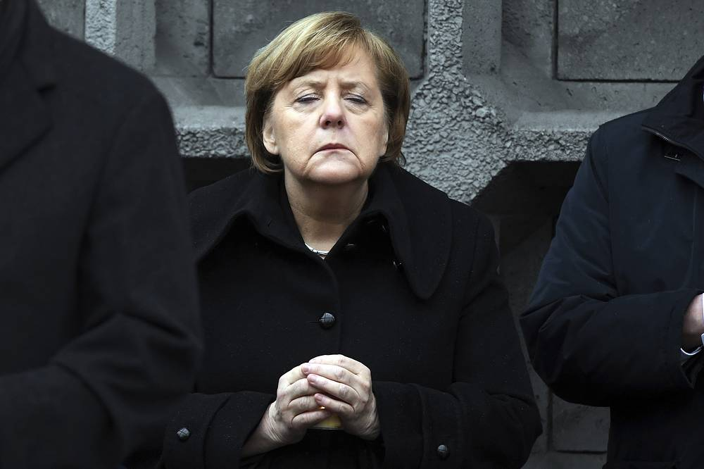 German Chancellor Angela Merkel at the opening of a memorial site to honor the victims of the Christmas market terrorist attack on the Breitscheid square at the Kaiser Wilhelm Memorial Church one year ago in Berlin, Germany, December 19