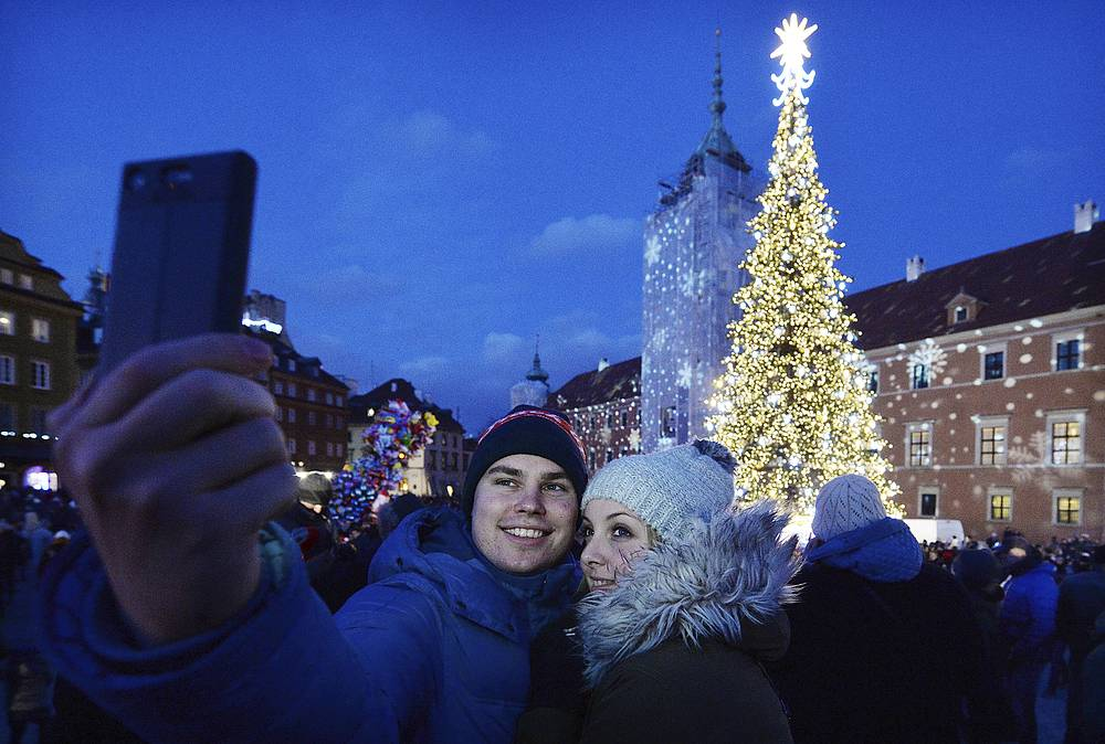 Spectators are taking selfie at the Royal Treaty street in Warsaw, Poland