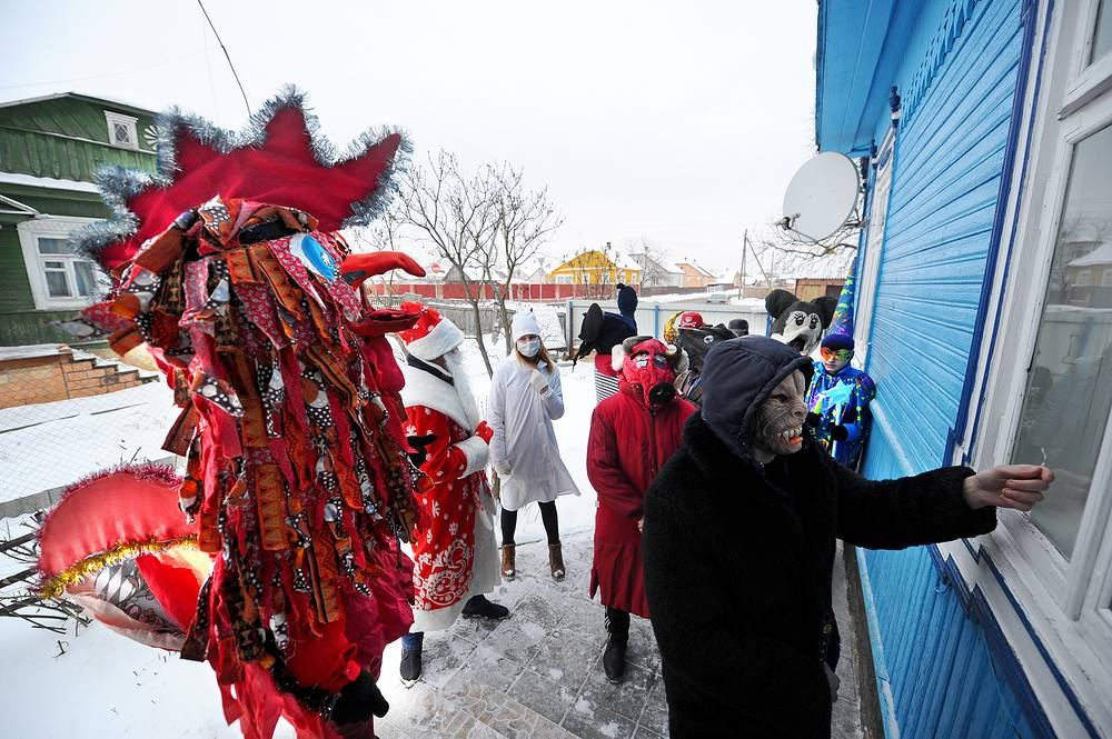 People dressed in costumes participate in Koniki carolling rite that emerged more than 100 years ago in Brest region, Belarus